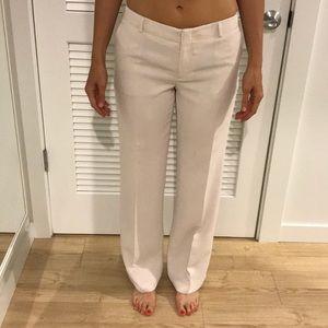Cream colored crepe wide leg trousers